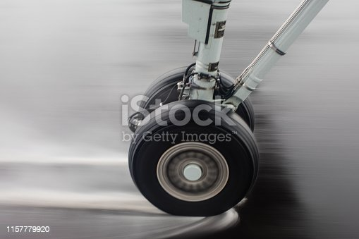 Commercial jet, tire, landing, rain, breaking