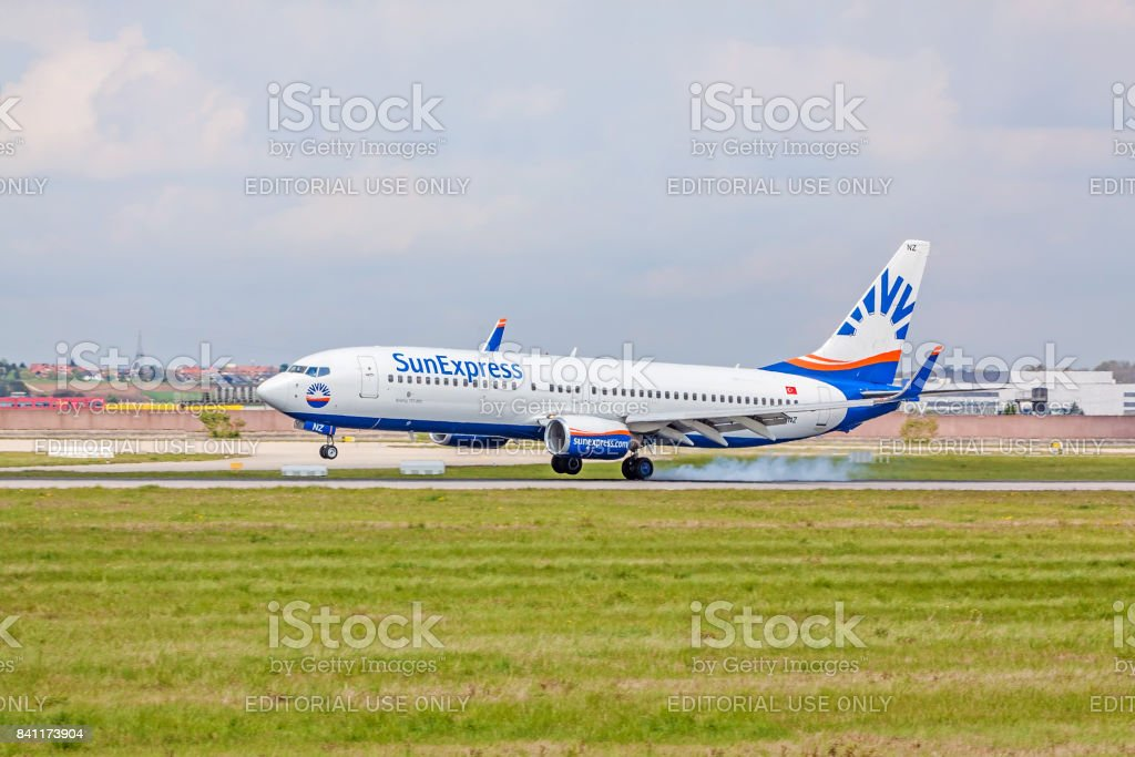 Airplane touchdown: SunExpress Boeing 737 landing, airport Stuttgart, Germany stock photo