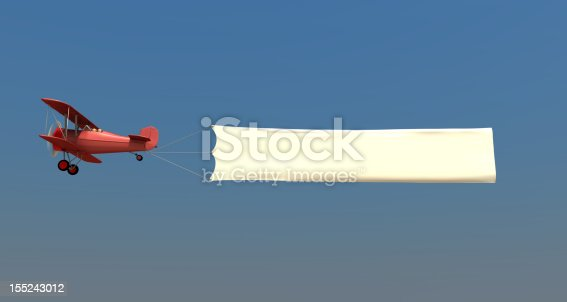 istock Airplane towing a banner 155243012