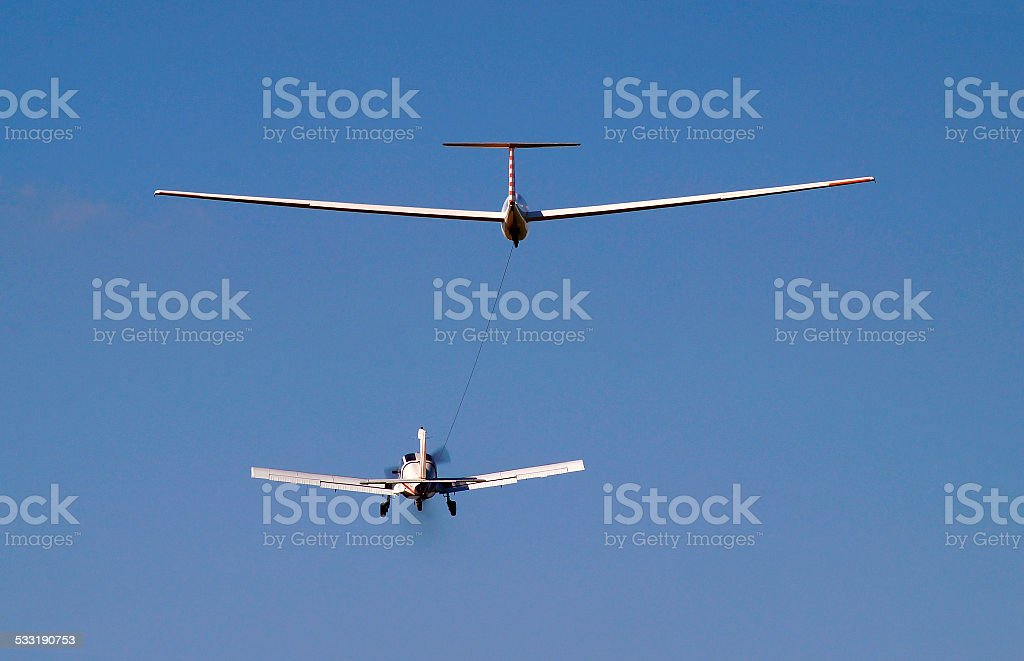 airplane towing a glider stock photo