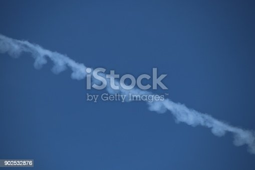 589538650 istock photo Airplane trace, Vapor Trail, in the blue sky 902532876