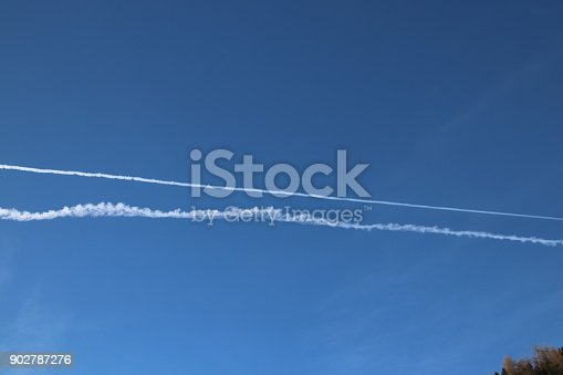 istock Airplane trace, Vapor Trail, in the blue sky 902787276