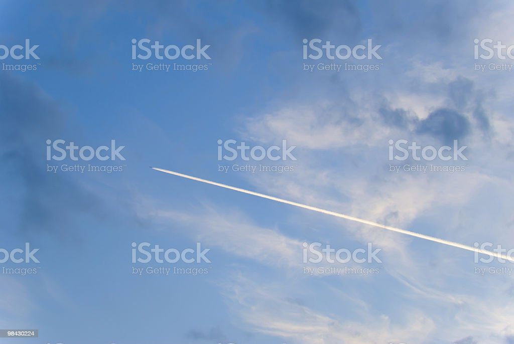 airplane trail across the sky royalty-free stock photo