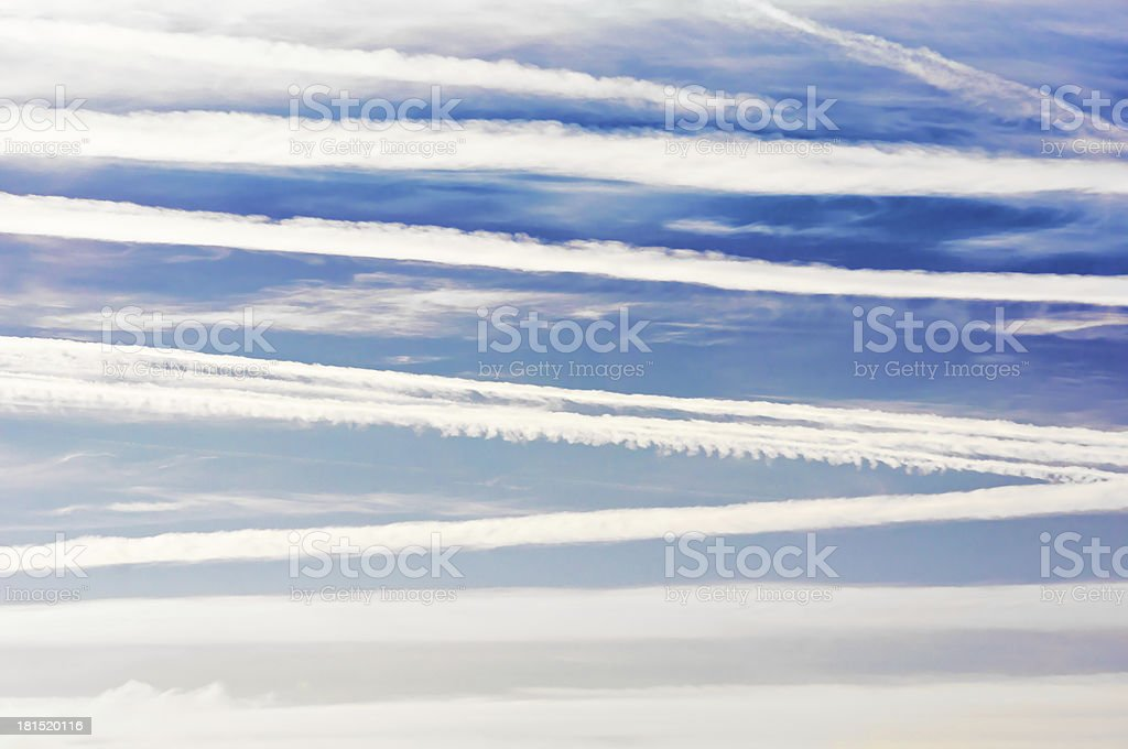 airplane trails and lines in blue sky royalty-free stock photo