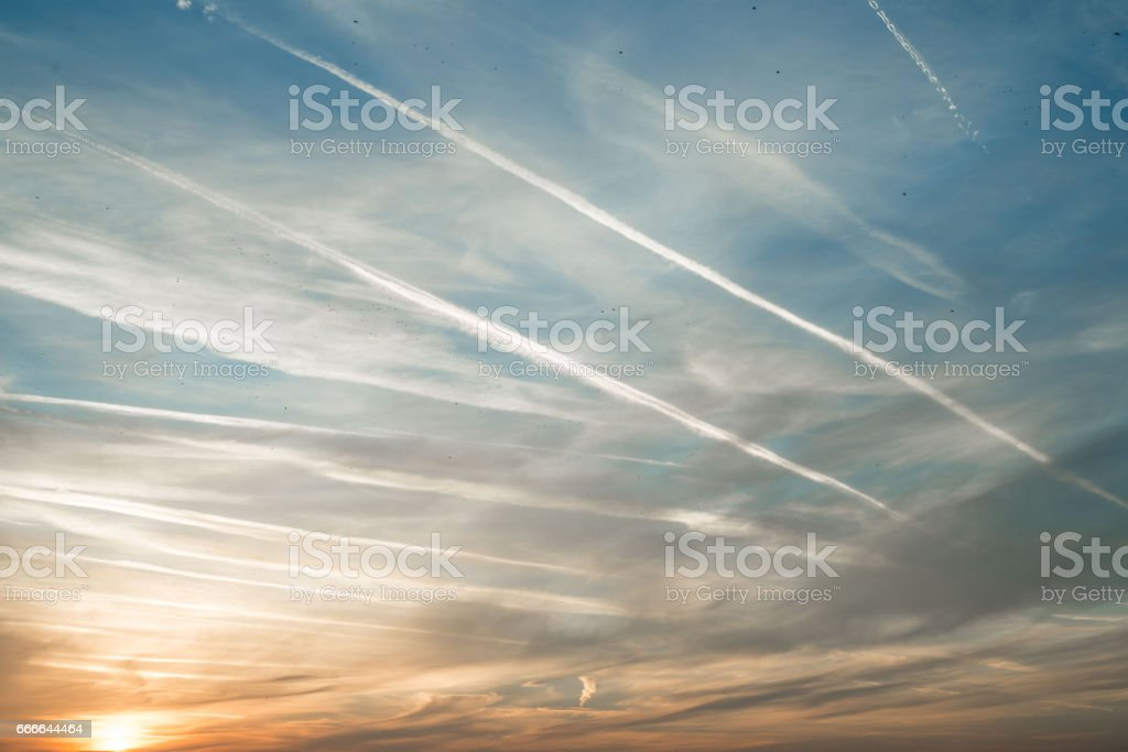 Airplane trails stock photo