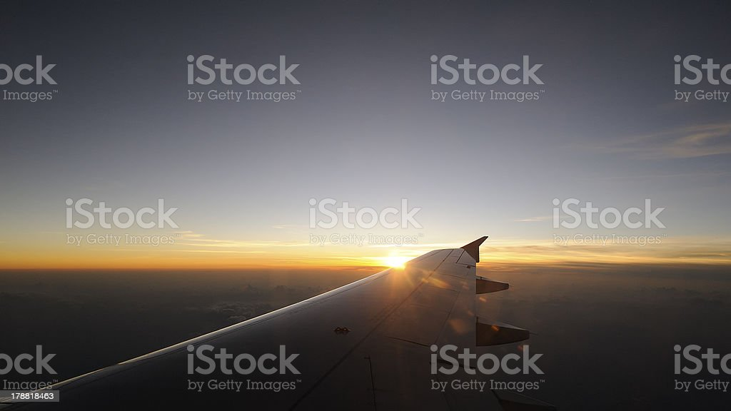 Airplane travel time is sunset royalty-free stock photo