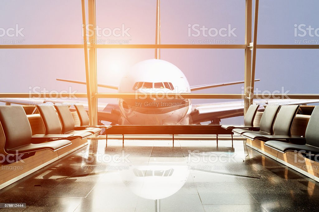 Airplane view from airport lounge in airport terminal. stock photo