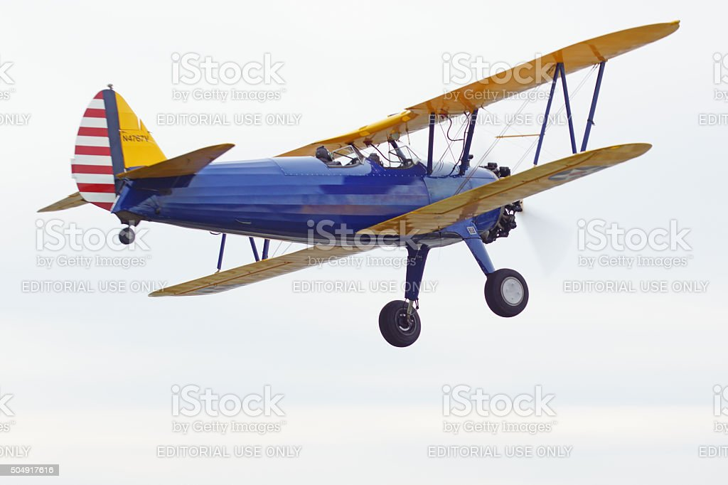 Airplane vintage Bi-plane flying stock photo