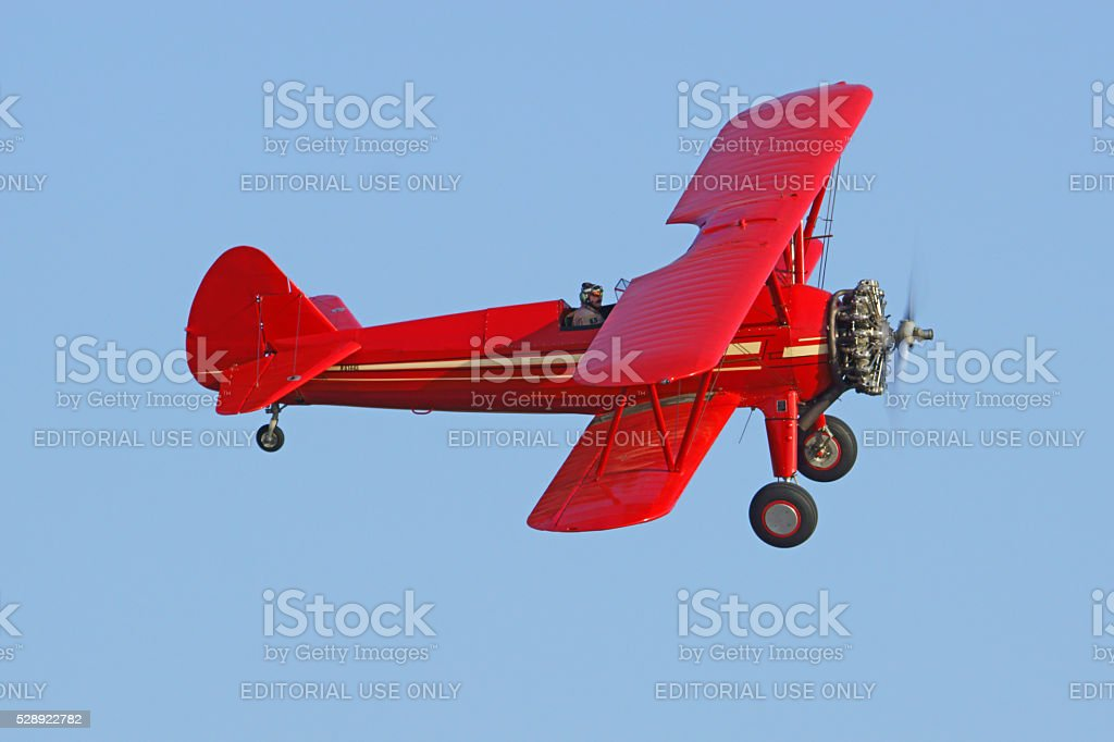 Airplane vintage bi-plane trainer flying stock photo