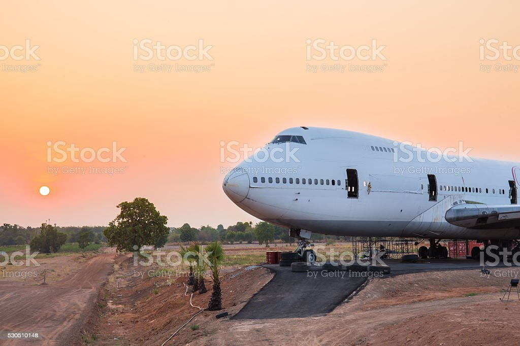 Airplane wait for maintenance at sunrise in outdoor stock photo