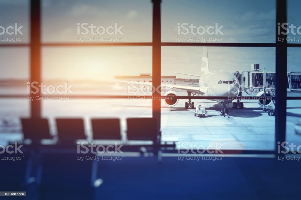 airplane waiting for departure in airport terminal stock photo