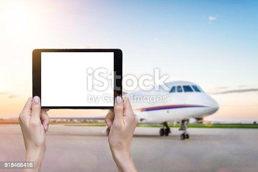 863476202 istock photo Airplane & white screen tablet 918466416