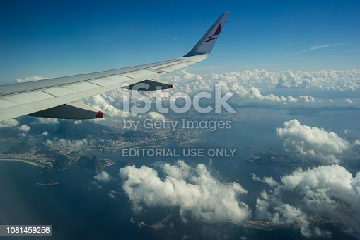 621114928istockphoto Airplane window landscape and clouds 1081459256