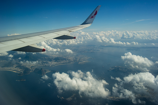 621114928 istock photo Airplane window landscape and clouds 1081459256