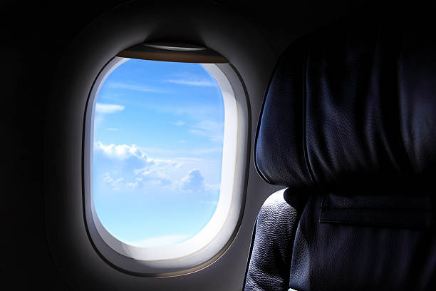 airplane window close up shot of airplane window.  supersonic airplane stock pictures, royalty-free photos & images