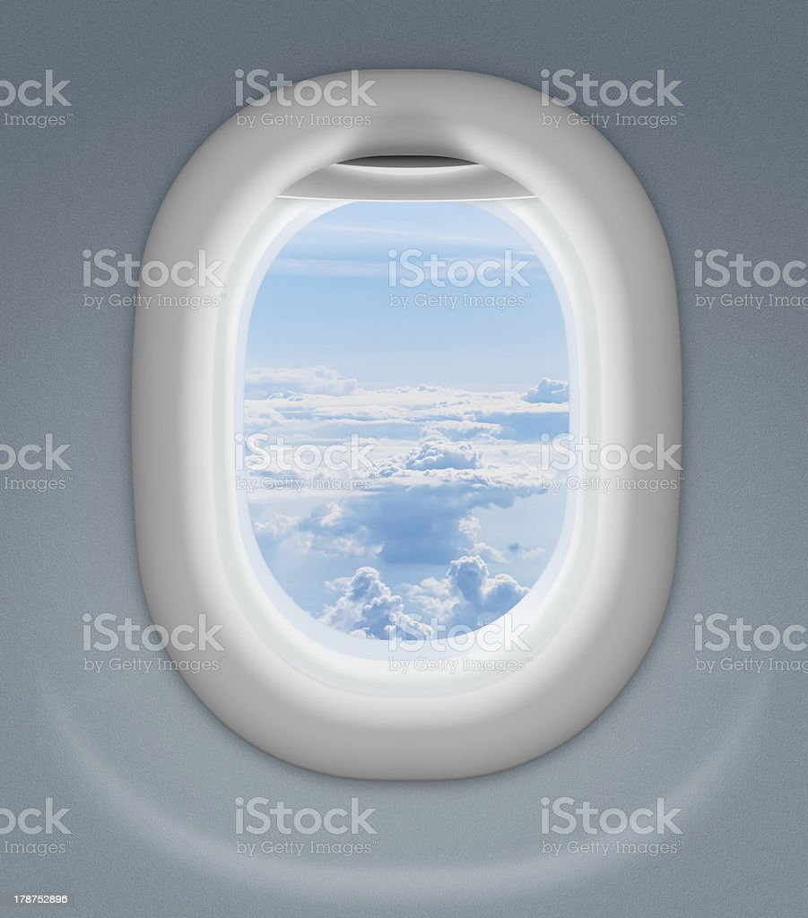 airplane window with cloud sky behind stock photo