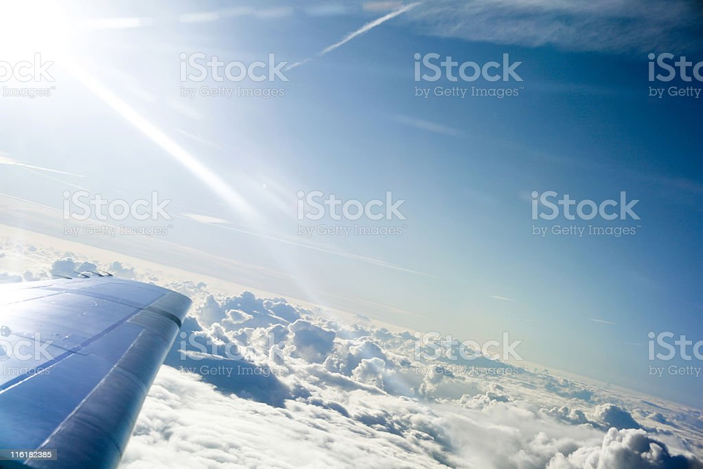Airplane wing above the clouds royalty-free stock photo