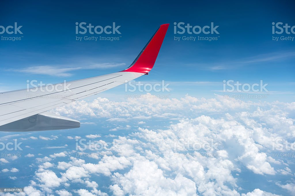 airplane wing above the clouds stock photo