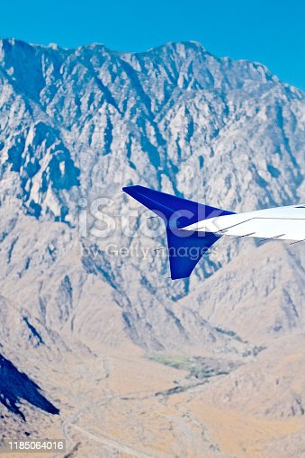 istock Airplane Wing against mountain backgrounds 1185064016