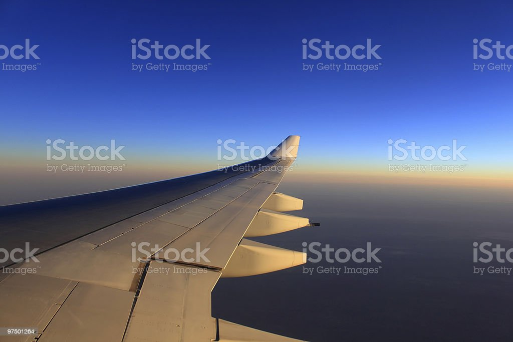 airplane wing and beautiful evening sky royalty-free stock photo