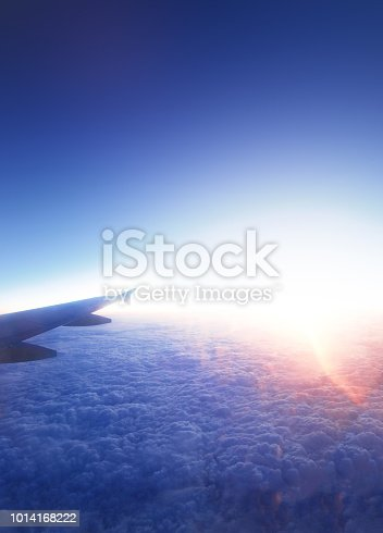 925925874 istock photo Airplane wing and beautiful  sunrise.  Travel concept