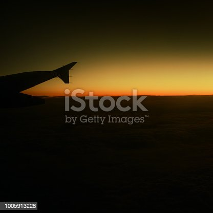 istock Airplane wing and beautiful  sunset.  Business trip. Commercial plane. Travel concept