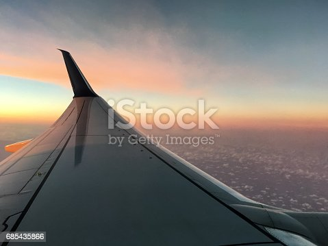 484616224 istock photo Airplane Wing and Dusk with Cloudscape 685435866