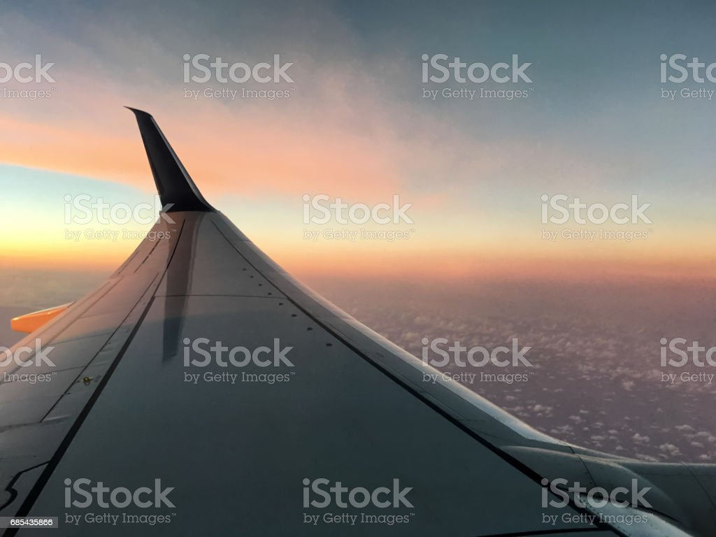 Airplane Wing and Dusk with Cloudscape stock photo