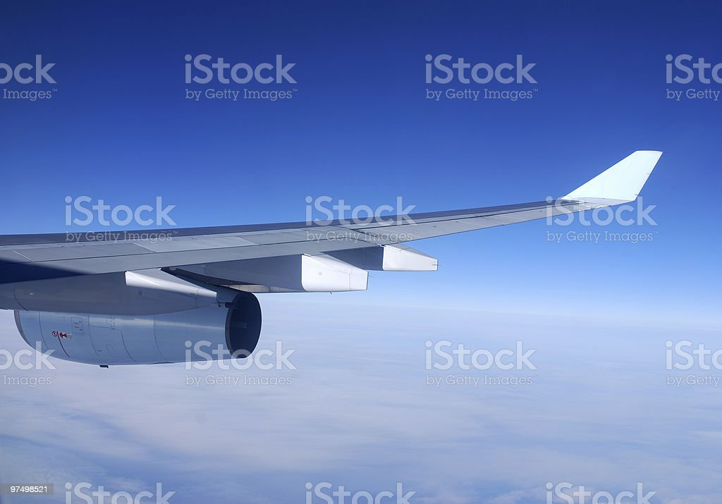 Airplane wing and engine royalty-free stock photo