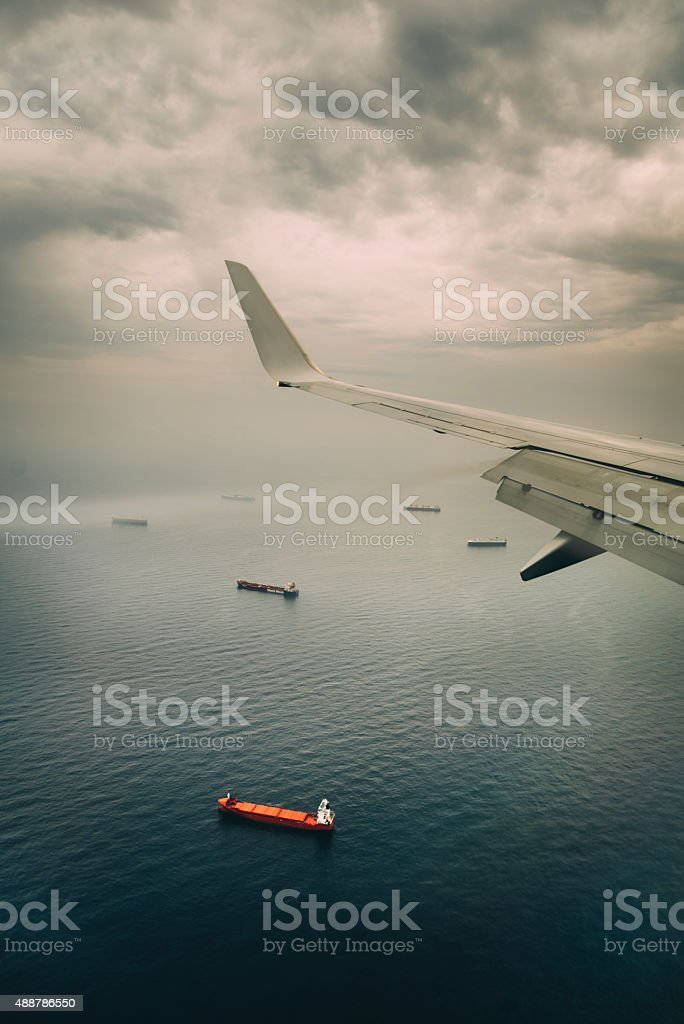 Airplane wing and ships stock photo