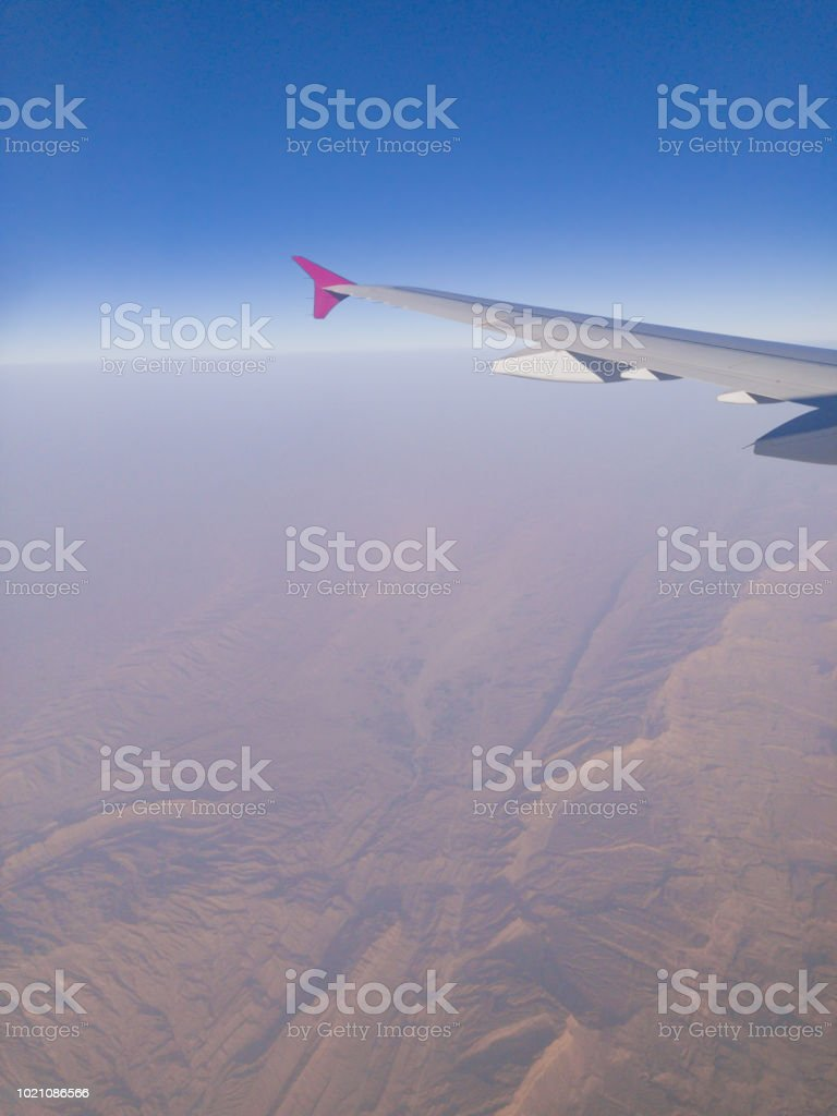 Airplane wing as seen from the passenger's seat. stock photo