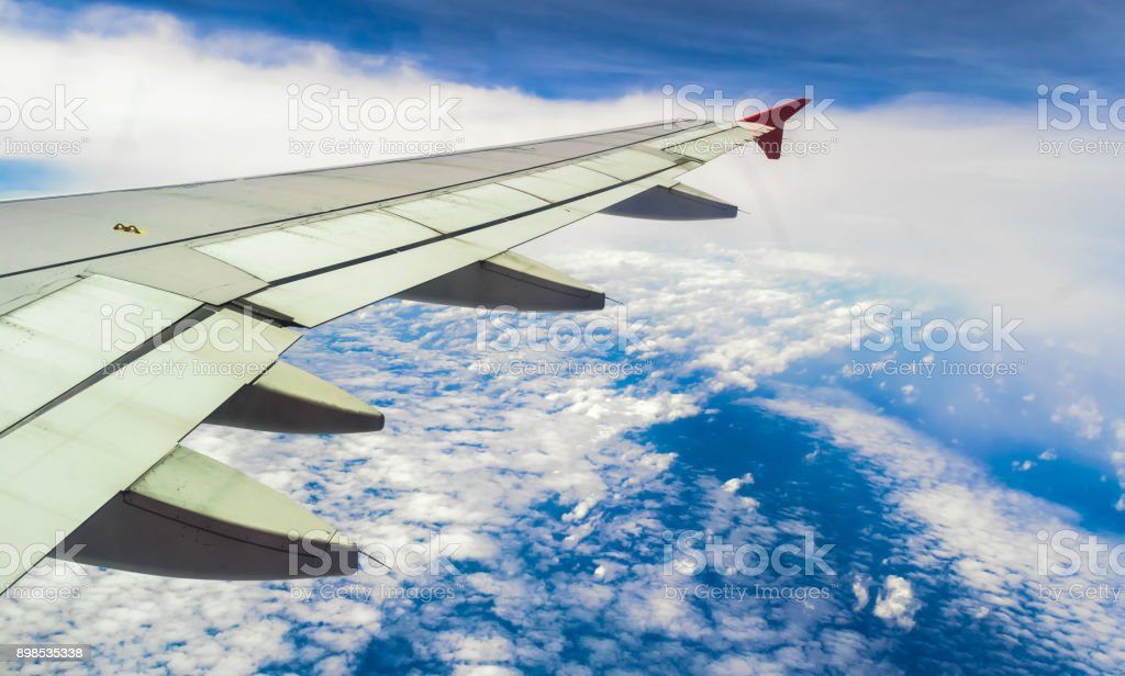 Airplane wing As the plane flew over the white clouds stock photo