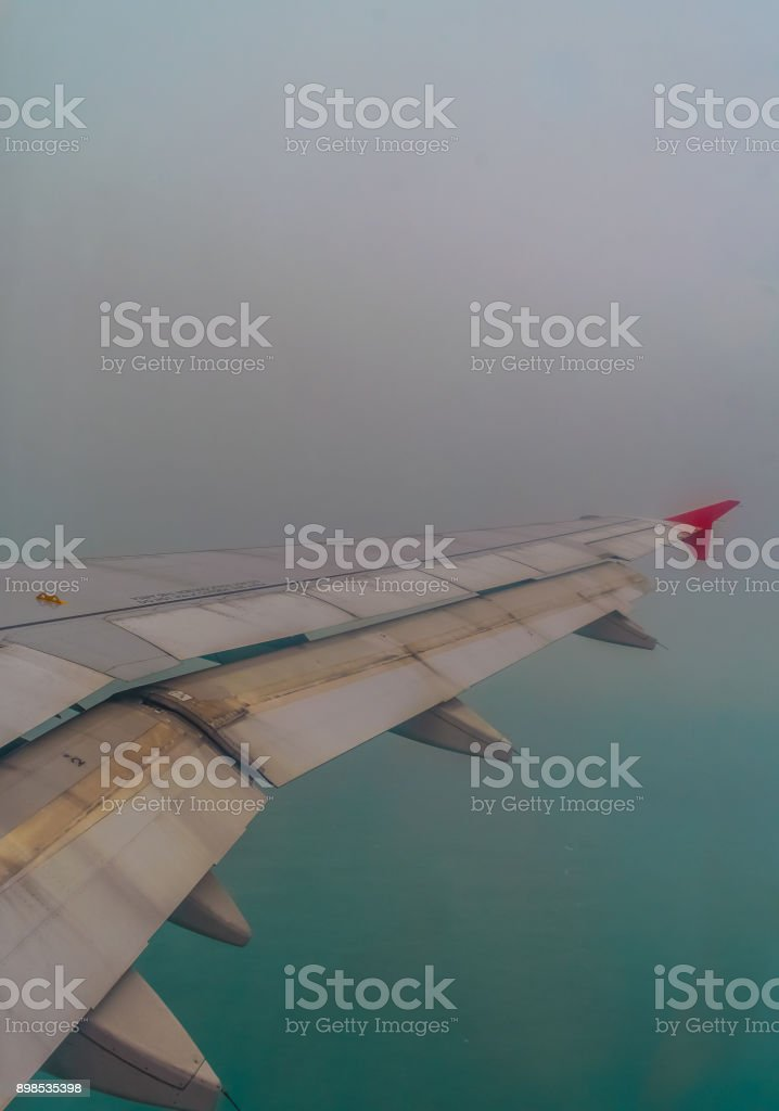 Airplane wing As the plane flew stock photo
