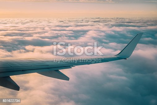 484616224 istock photo Airplane wing at sunset 831622734
