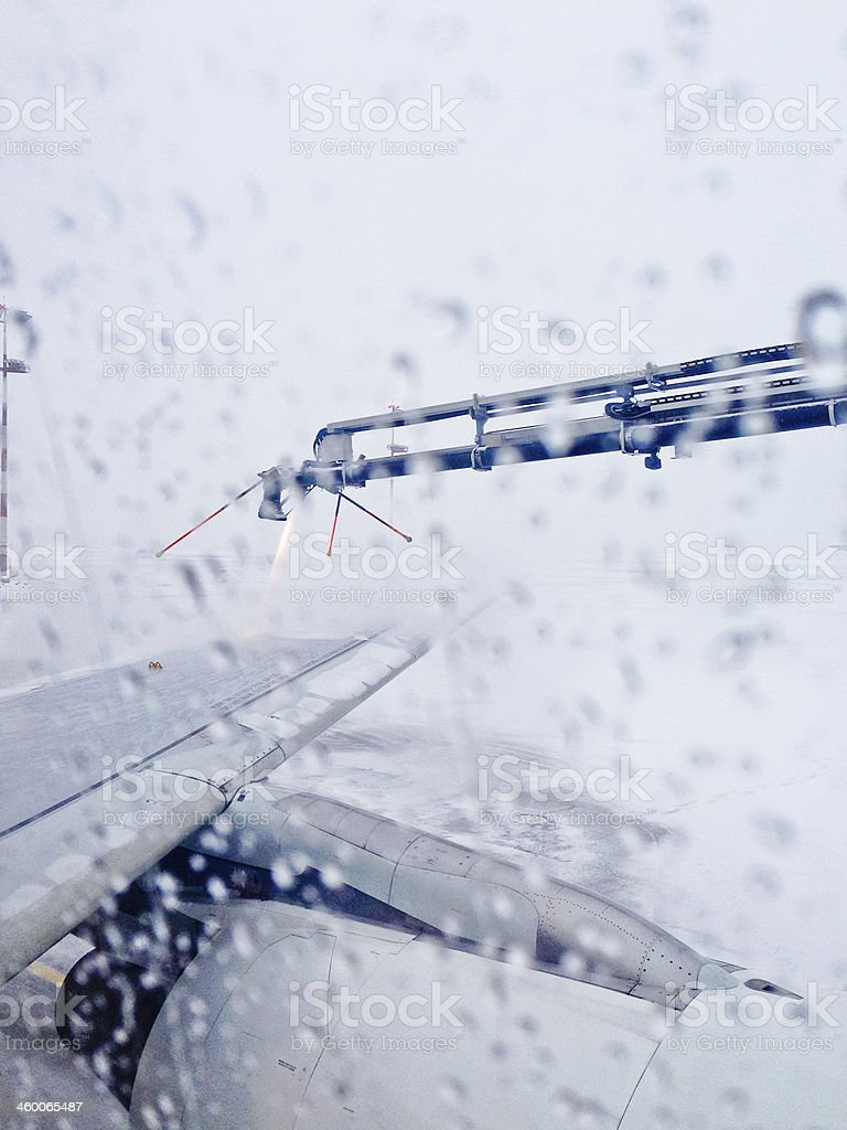Airplane Wing being Defrosted by robot before take-off stock photo