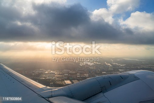Airplane wing flying above the clouds in Berlin, Germany