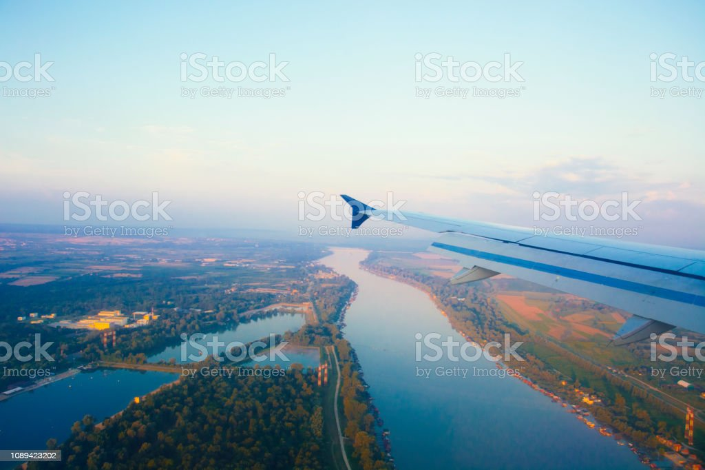 Airplane Wing Flying on Top of France stock photo