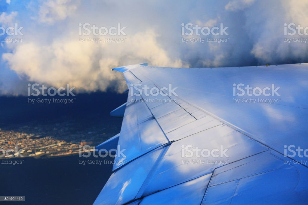 Airplane Wing in Flight from window stock photo