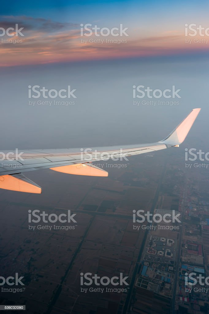 Airplane wing in the sky at North of china royalty-free stock photo
