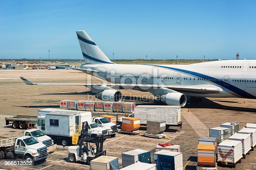 186763256istockphoto Airplane wing luggage and cargo at the international airport 966513522