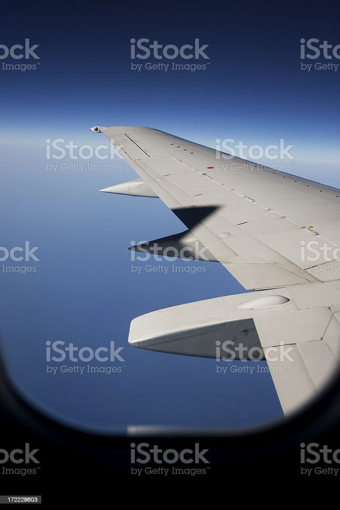 Airplane Wing on Horizon, Shot Through Window, Copy Space royalty-free stock photo