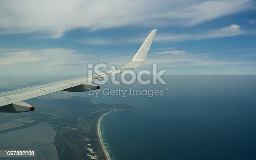 902818356 istock photo Airplane wings, view and sea 1097882238