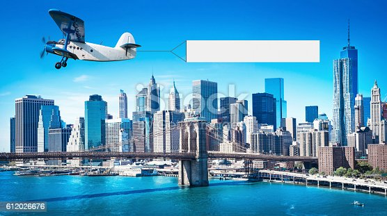 istock airplane with a banner 612026676