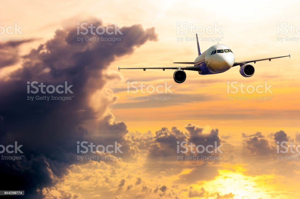 Airplane with background of cloudy sky in golden time, exploration conceptual stock photo
