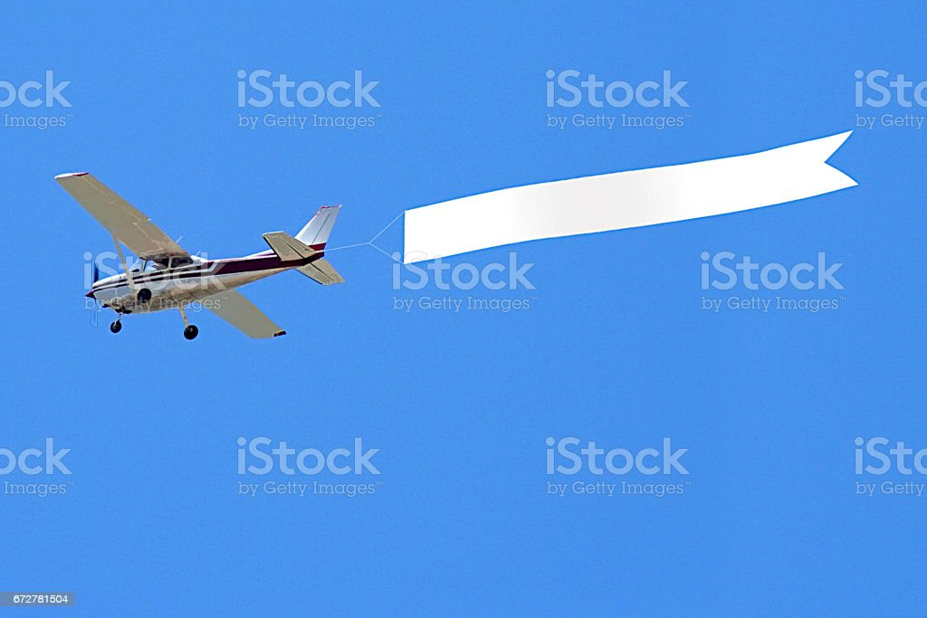 Airplane with banner stock photo