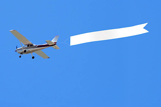 Airplane with banner - foto stock