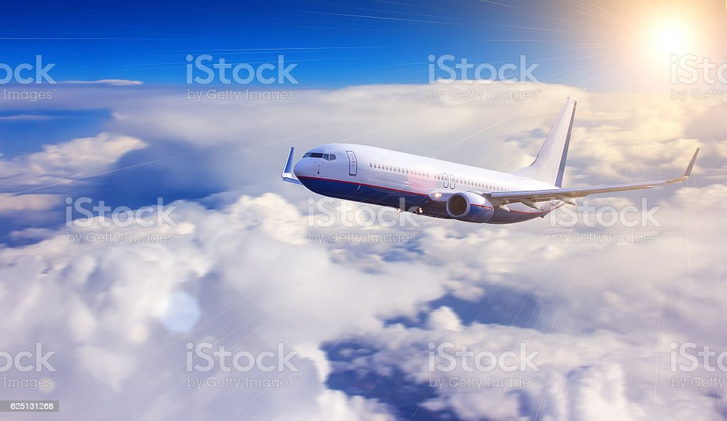Airplane with blue sky and clouds on background stock photo