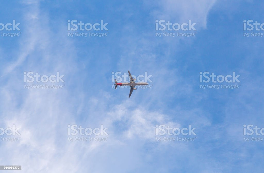 Airplane with blue sky. Low angle shot stock photo