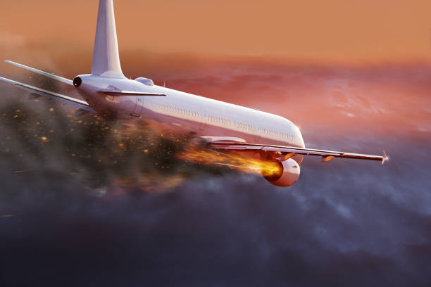 Airplane with engine on fire, concept of aerial disaster stock photo