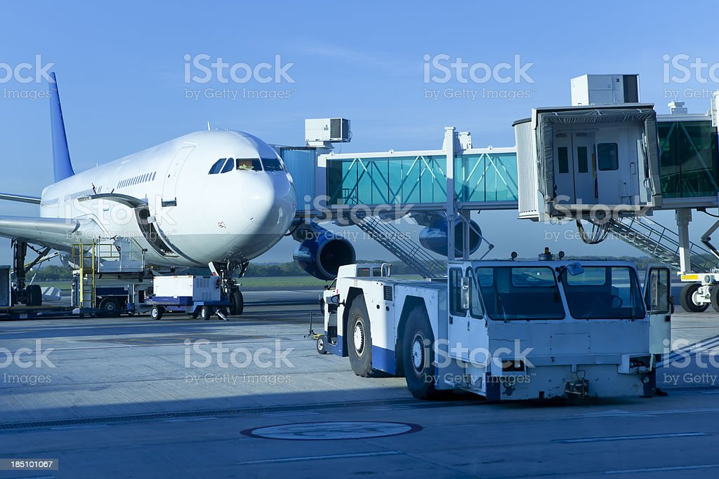 Airplane with gangway waiting for the passengers at morning stock photo